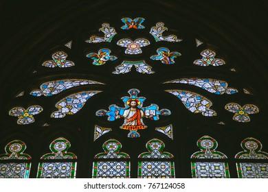 Prague, Czech Republic - July, 20, 2014: Stained-glass Window designed by Art Nouveau painter Alfons Mucha in St. Vitus Cathedral, Prague, Czech Republic