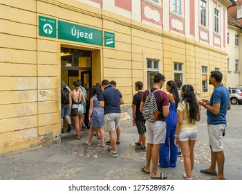 PRAGUE, CZECH REPUBLIC - JULY 2018: People queuing to enter the station of the funicular railway, which takes people to the top of Petrin Hill overlooking the city of Prague.