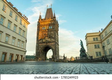 Prague, Czech Republic July 2020. view of the bridge tower in front of the Charles Bridge and the statue of King Charles IX