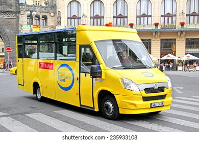 PRAGUE, CZECH REPUBLIC - JULY 21, 2014: Yellow sightseeing bus Mave (Iveco Daily) at the city street.