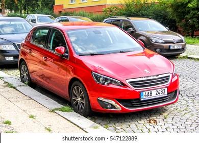 PRAGUE, CZECH REPUBLIC - JULY 22, 2014: Red car Peugeot 308 in the city street.