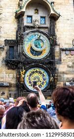 Prague, Czech Republic -July 23,2017: Prague chimes or eagle clock (Czech Prazsky orloj, also Czech Staromestsky orloj) .The medieval clock tower, mounted on the south wall of the Old Town Hall tower