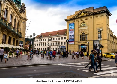 Prague, Czech Republic -July 23,2017: Hybernia Theatre from bottom in a cloudy day. Advertisments of upcoming shows on wall