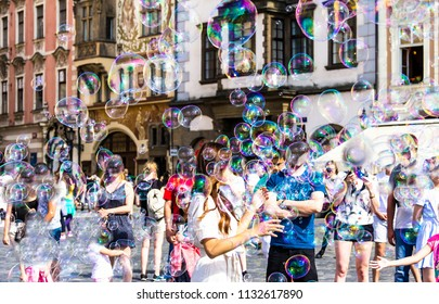 Prague, Czech Republic -July 23,2017: Street performer making bubbles to entertain people at Staromestske namesti Old Town Square