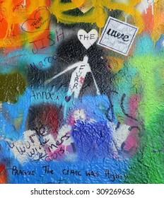 PRAGUE, CZECH REPUBLIC - July 24: The Lennon Wall since the 1980s is filled with John Lennon-inspired graffiti and pieces of lyrics from Beatles songs on July 24, 2015 in Prague, Czech Republic