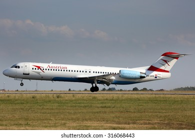 PRAGUE, CZECH REPUBLIC - JULY 31: Austrian Airlines Fokker 100 lands at PRG Airport on July 31, 2015. Austrian Airlines is the flag carrier of Austria.