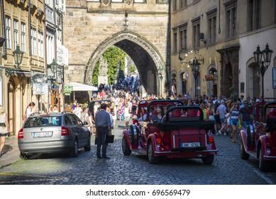 PRAGUE, CZECH REPUBLIC - July 31 2017 : Tourists on foot Street in old town PRAGUE in Czech Republic