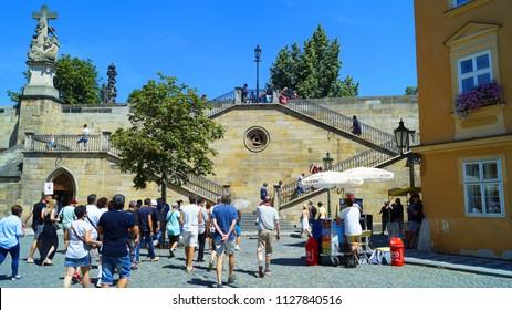 Prague, Czech Republic July 4, 2018 - Tourists climb the Charles Bridge on a beautiful staircase