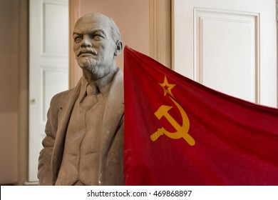 PRAGUE, CZECH REPUBLIC, JULY 6,2016: Statue of Vladimir Lenin and USSR flag inside Museum of Communism, Prague, Czech Republic.