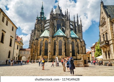 PRAGUE, CZECH REPUBLIC, JULY 7, 2016: Tourists walking in front of St. Vitus Cathedral inside The Prague Castle complex, Czech Republic.