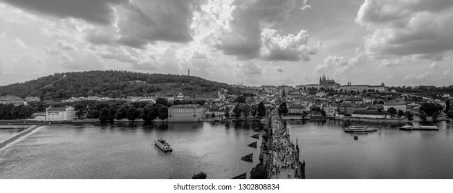 Prague, Czech Republic Jun 08 2018. Panoramic view Tourists on Charles Bridge in Prague. Its construction started in 1357 under King Charles IV. Today is the most visited place