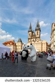 Prague, Czech Republic Jun. 09. 2018:  Two mascot panda bear dancing in front of  the Tyn  (Church of Our Lady).