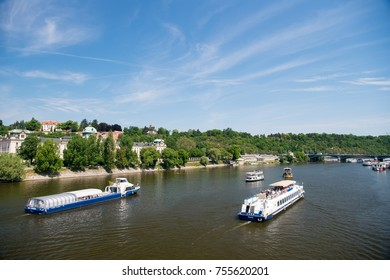 Prague, Czech Republic - June 03, 2017: river cruise ships and city skyline on sunny day on blue sky background.