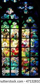 PRAGUE, CZECH REPUBLIC - JUNE 05, 2016: Stained-glass Window designed by Art Nouveau painter Alfons Mucha in St. Vitus Cathedral, Prague, Czech Republic