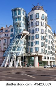 PRAGUE, CZECH REPUBLIC - JUNE 06. 2016: Famous Dancing House (nicknamed Ginger and Fred) with tourists and Street traffic on July 06, 2016 in Prague, Czech Republic.