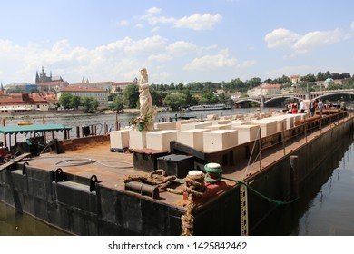 PRAGUE, CZECH REPUBLIC - JUNE 15 2019 - Ship with parts of Mariansky sloup (pole) ready to be installed at Staromestske namesti (Old Town Square) in Prague waiting at Vltava river