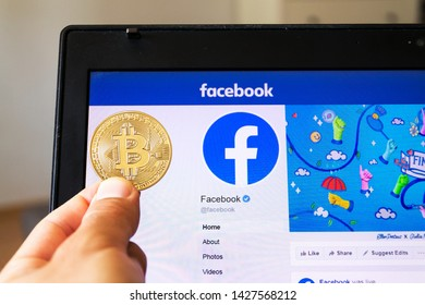 PRAGUE, CZECH REPUBLIC - JUNE 18 2019: Golden bitcoin lying homepage of Facebook launching digital wallet Calibra and cryptocurrency Libra on June 18, 2019 in Prague, Czech Republic.