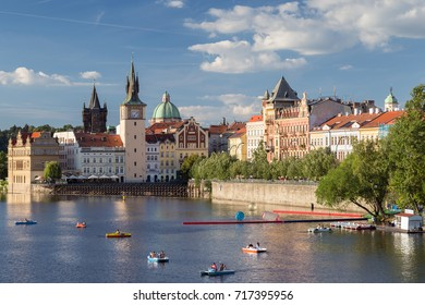 PRAGUE, CZECH REPUBLIC - JUNE 19, 2017: View of rowers at the Vltava River and old buildings at the Old Town in Prague, Czech Republic.