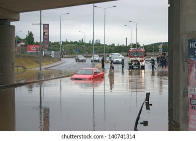 PRAGUE, CZECH REPUBLIC - JUNE 2: Stranded car in flooded road, under bridge, because of the flooding, fire brigade rescuing it on June 2, 2013 in Prague, Czech Republic