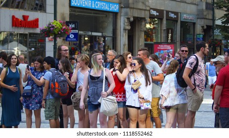 Prague, Czech Republic June 20, 2018 - A group of young and beautiful people are walking along the Wenceslas Square in Prague