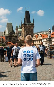 Prague, Czech Republic. June, 2018. Boy teenager in a T-shirt with logos of social networks Twitter, Facebook, Snapchat, Instagram, Blogger, Linkedin.