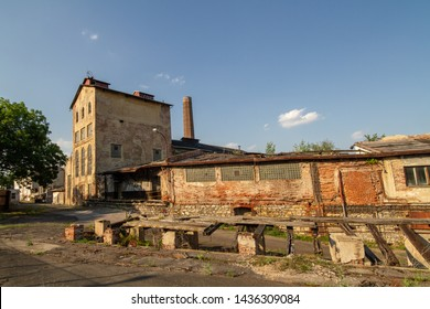 Prague, Czech republic - June 26 2019: Former distillery and potash and vinegar refinery at Zlichov district, now a brownfield. Its digester building and chimney are protected cultural monuments.