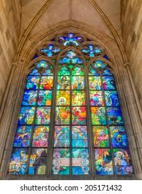 PRAGUE, CZECH REPUBLIC - JUNE 27, 2014: Stained-glass Window designed by Art Nouveau painter Alfons Mucha in St. Vitus Cathedral, Prague, Czech Republic. Hdr image.