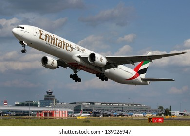 PRAGUE, CZECH REPUBLIC - JUNE 28: Emirates Boeing 777-31H takes off from PRG Airport on June 28, 2012. Emirates is rated as a top 10 best airlines in the world flying on youngest fleet.