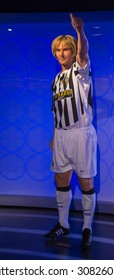 PRAGUE, CZECH REPUBLIC - JUNE 29, 2015: Pavel Nedven, famous Czech footballer in a Juventus kit, Grevin museum. Grevin is the museum of the wax figures in Prague