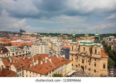 PRAGUE, CZECH REPUBLIC - JUNE 3, 2018: Aerial view of Prague Old Town square with Church of St. Nicholas. Famous tourist destination on 03 June, 2018