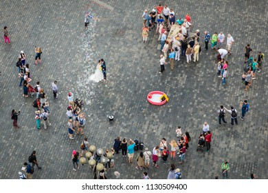 PRAGUE, CZECH REPUBLIC - JUNE 3, 2018: Aerial view of Prague Old Town square crowd with a wedding photography scene on 03 June, 2018