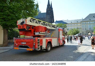 Prague / Czech Republic - June 3 2019:  A firetruck passing through Prague Castle area full of tourists