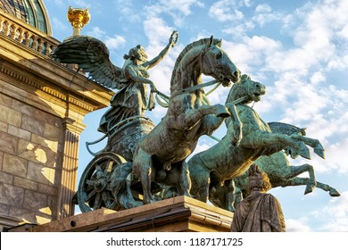 Prague, Czech Republic - June 30, 2018: Left three-horse chariot sculpture installed on the roof corners of the National Theatre in Prague. The horses are controlled by the winged goddess Victoria