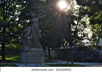 Prague / Czech Republic - June 5 2019: The sculpture of czech legendary queen Libuse and king Premysl, the Ploughman (Orac) by J. V. Myslbek at Vysehrad,sunset with contrast and impressive sun