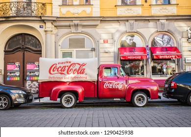 PRAGUE, CZECH REPUBLIC - JUNE 7, 2017: : Red retro car Ford F-100 with advertising inscription Coca Cola on board on the streets of Prague's Old Town