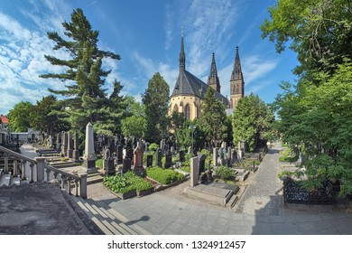PRAGUE, CZECH REPUBLIC - JUNE 8, 2010: Vysehrad Cemetery and Basilica of St. Peter and St. Paul. The Cemetery is the final resting place of more then 600 figures of the Czech culture.
