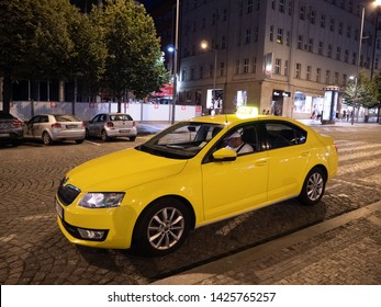 Prague, Czech Republic - June 9 2019: Yellow Cab or Taxi waiting on Wenceslas Square, called Vaclavske Namesti in Czech, at Night in Prague.