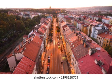 Prague, Czech Republic: Late evening panorama view over red tile roofs of Praha 2 district, Jaromirova street, wall of Vysehrad castle and Saint Peter and Paul Basilica far away.