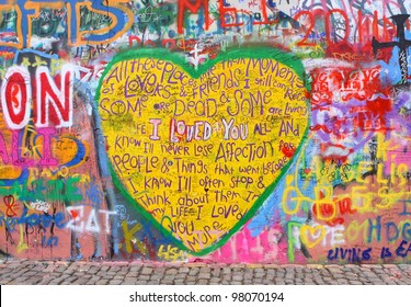 PRAGUE, CZECH REPUBLIC - MARCH 07:The Lennon Wall since the 1980s filled with John Lennon-inspired graffiti and pieces of lyrics from Beatles songs on Mar 13, 2012 in Prague, Czech Republic