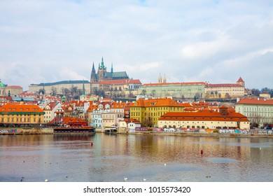Prague, Czech Republic - March 11 2015: Scenic view on Vltava river and historical center of Prague, buildings and landmarks of old town, Prague, Czech Republic