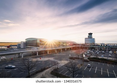 Prague, Czech Republic - March 13, 2019: Terminal building and air traffic control tower at Vaclav Havel Airport Prague on March 13, 2019.