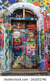 PRAGUE, CZECH REPUBLIC - MARCH 13:The Lennon Wall since the 1980 filled with John Lennon-inspired graffiti and texts from Beatles songs on March 13, 2015 in Prague, Czech Republic