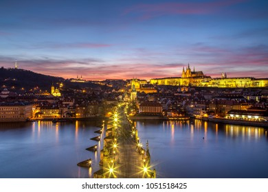 Prague, Czech Republic - March 16, 2017: Evening view of Prague Castle and Charles Bridge from the Old Town Bridge Tower