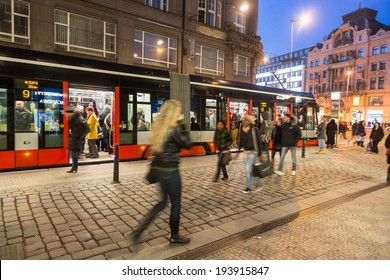 PRAGUE, CZECH REPUBLIC - MARCH 16,2013: People at tram stop next to Wenceslas Square at night