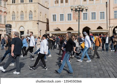 Prague / Czech Republic - March 17 2019: tourists dancing the cupid shuffle dance with street performers on Old Town Square