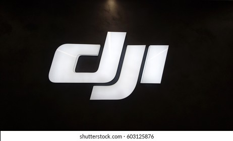 PRAGUE, CZECH REPUBLIC - MARCH 17, 2017: DJI logo on the official store in Prague. DJI is the leading company in the civilian drone industry.