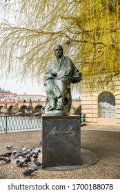 Prague, Czech republic - March 19, 2020. Novotneho lavka area with Bedrich Smetana statue by the Vltava river without tourists during travel ban