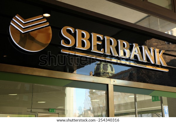 PRAGUE, CZECH REPUBLIC - MARCH 20, 2013: Sign of a new opened flagship branch of Sberbank in Prague, Czech Republic. Sberbank, the largest bank in Russia, started operations in Europe.