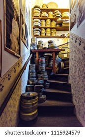 PRAGUE, CZECH REPUBLIC - MARCH 23, 2018: Stairs inside Franza Kafka former house, part of the castle. A bunch of movie film reel cases and drawings on walls
