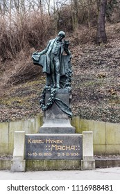 PRAGUE, CZECH REPUBLIC - MARCH 24, 2018: Monument of the poet Karel Hynek Macha located in Petrin Park. Dried trees and dramatic park on background